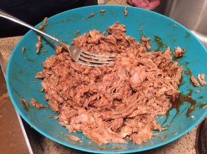 Pulled pork mixed with grilling sauce.