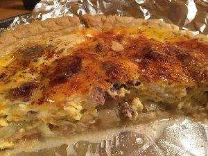 Bratwurst and onion quiche half consumed.