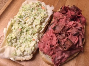 Sweet & Hot mustard, Swiss cheese, coleslaw, roast beef on seedless rye ready to be put together.