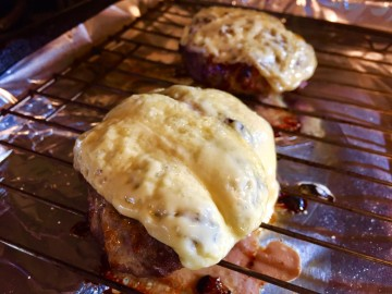 Burgers with melted cheese.